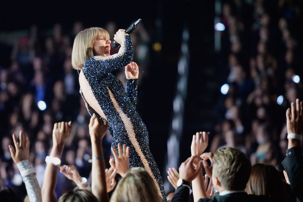 Frequent Spotify critic and Album of the Year winner Taylor Swift opened the Grammys.