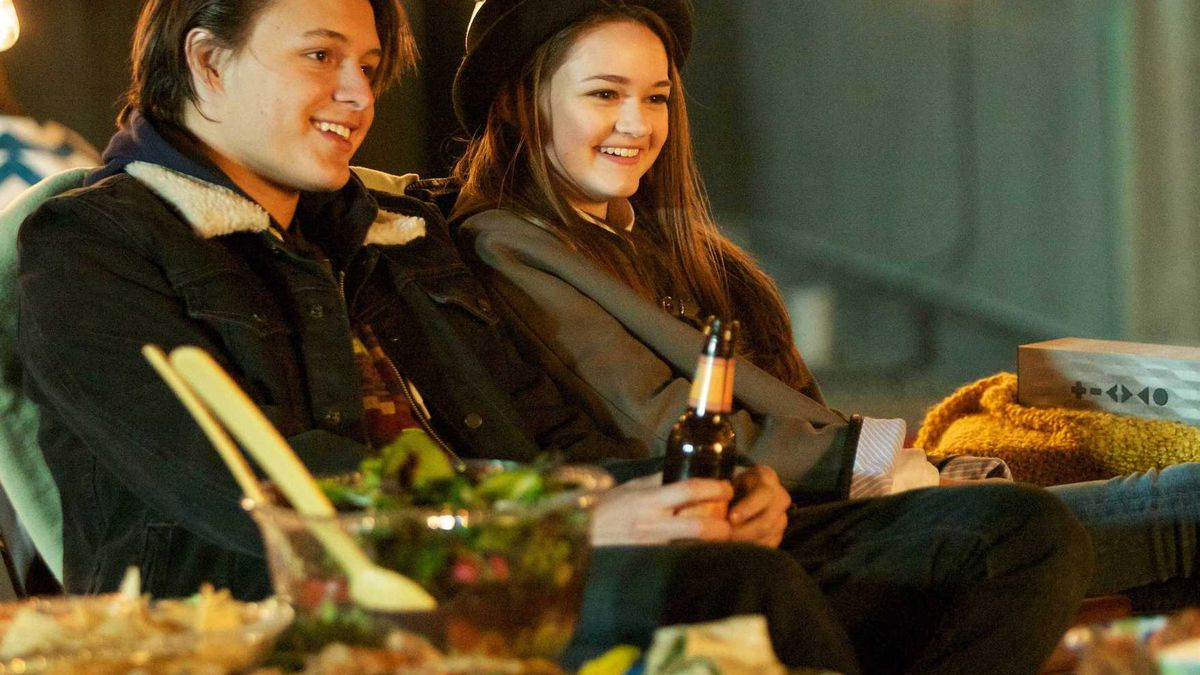 Emma, the cool girl, and Leo sit on a couch on the roof of the hospital