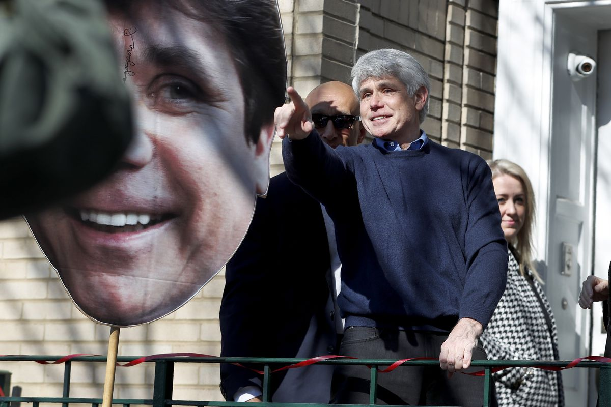 Former Illinois Gov. Rod Blagojevich points to supporters after a news conference outside his home a day after President Donald Trump commuted his prison sentence for political corruption.