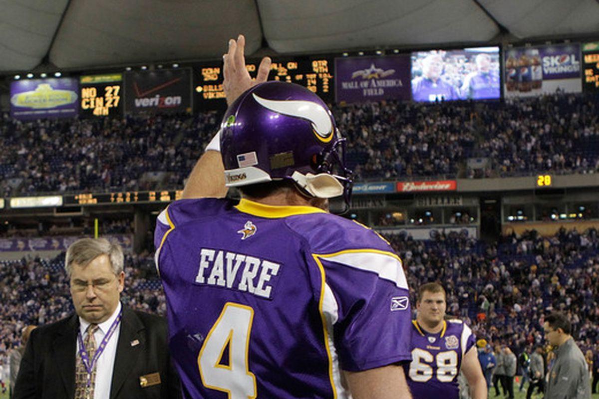 One former Vikings quarterback waves goodbye to another former Vikings quarterback.