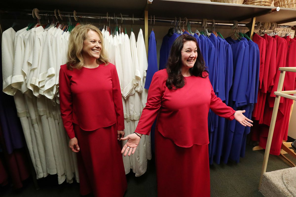 Debbie Matheson, left, and McKenna Reynolds try on a dresses in preparation to sing with The Tabernacle Choir at Temple Square during a rehearsal in Salt Lake City on Friday, April 12, 2019. Four people have been selected through social media to sing with