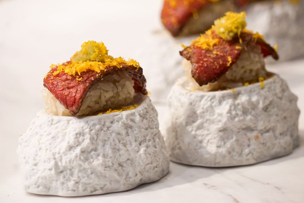 """Wagyu nigiri with wild boar jerky shavings, cured egg yolk, and """"wasabi"""" from Imperfecto"""