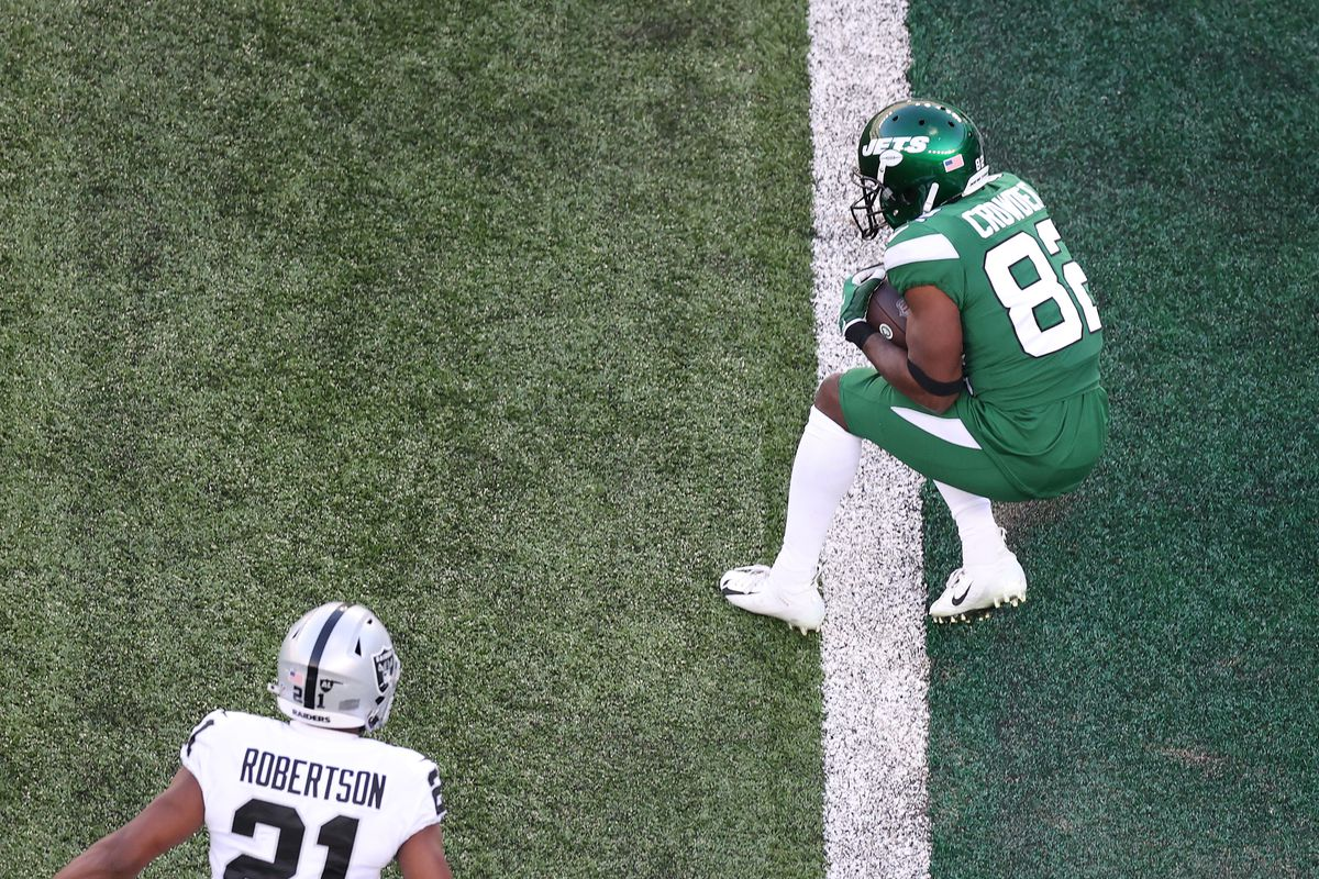 Jamison Crowder #82 of the New York Jets catches a touchdown pass during the first half against the Las Vegas Raiders at MetLife Stadium on December 06, 2020 in East Rutherford, New Jersey.