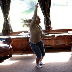 Annalise Simmons dances at her home in Kamas on Saturday, Aug. 24, 2013. She was adopted from Russia.