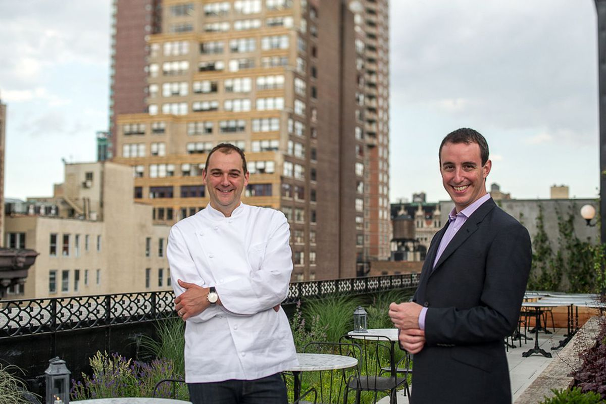 Daniel Humm and Will Guidara on the Nomad rooftop smiling