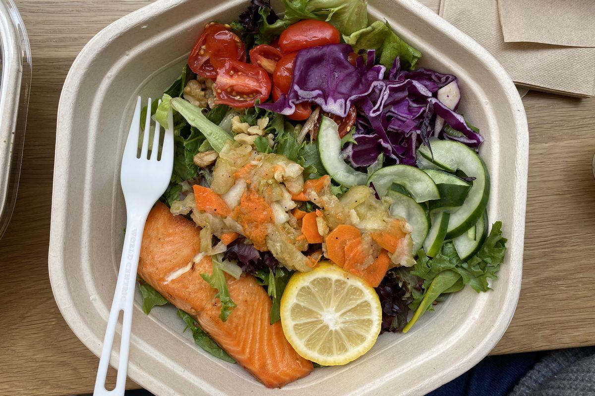 Orange steelhead trout sits over a Green Goddess salad at Sweetgreen