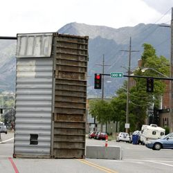 A shipping container marks the entrance to what will be a festival destination on 700 South and 300 West in the Granary District of Salt Lake City on Thursday, May 30, 2013. Starting mid-June, the street will become a festival site Thursday and Friday evenings and Saturdays through the summer. Shipping containers will line the center of the street where local artisans and entrepreneurs will sell their work. Live music, food and a beer garden will also be part of the festival. Jewelry designers, artists, clothing designers, a bicycle shop and a cupcake maker will occupy the shipping containers.
