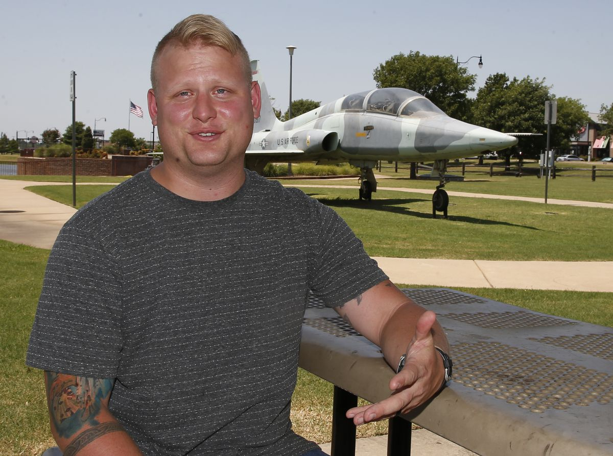 Travis Rader, a naval physical security officer, poses for a photo near Tinker Air Force Base in Midwest City, Okla. Rader says allowing beards would boost morale for men. | AP Photo/Sue Ogrocki