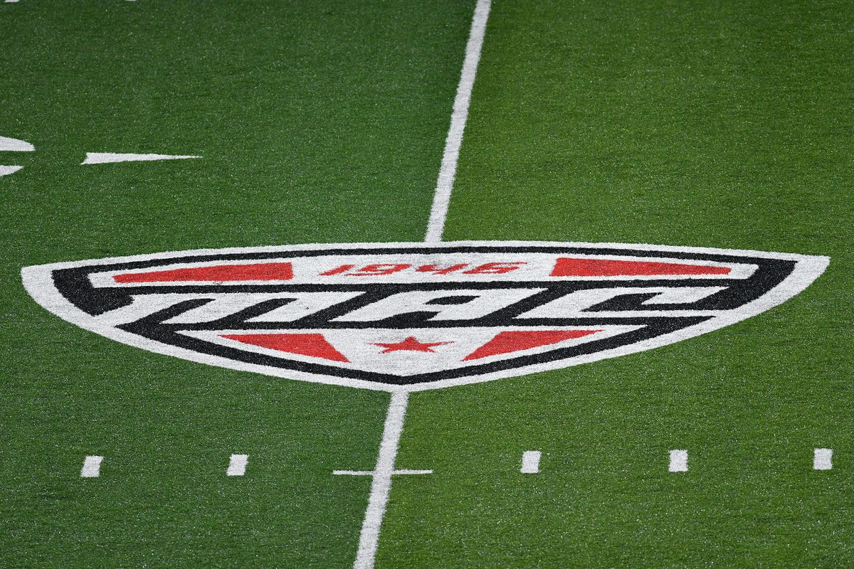 The Mid-American Conference logo is displayed on the field during the college football game between the Central Connecticut State University Blue Devils and the Ball State Cardinals on August 30, 2018, at Scheumann Stadium in Muncie, Indiana.