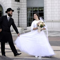 Rabbi Mendy Cohen and Chaya Zippel pose for wedding photos after their traditional Chabad Lubavitch Jewish wedding at the Grand America Hotel in Salt Lake City on Monday, Sept. 12, 2016.