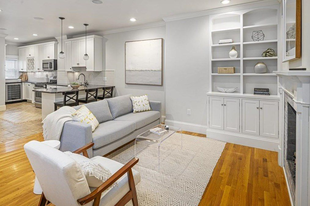 An open living room with furniture and cabinetry.