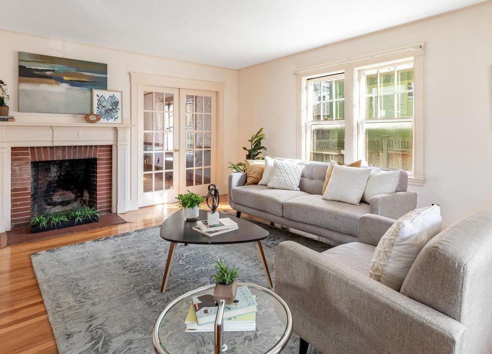 Living room features a wood burning fireplace and french doors