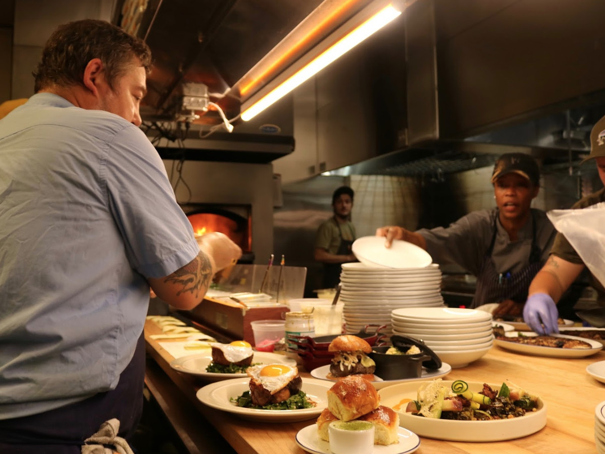 Chef and owner Terry Koval inspecting dishes prior to being served at The Deer and the Dove