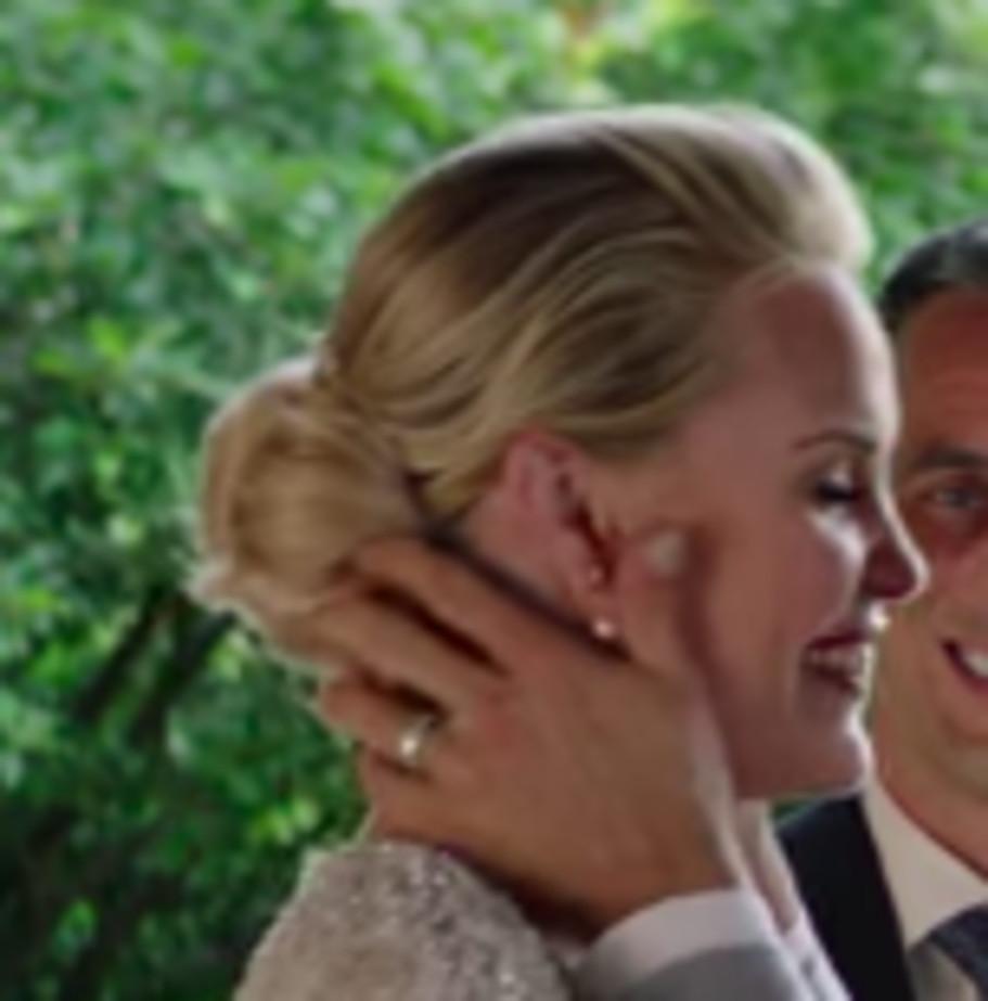 Close-up of Jeremy Renner's hands on Leslie Bibb's face