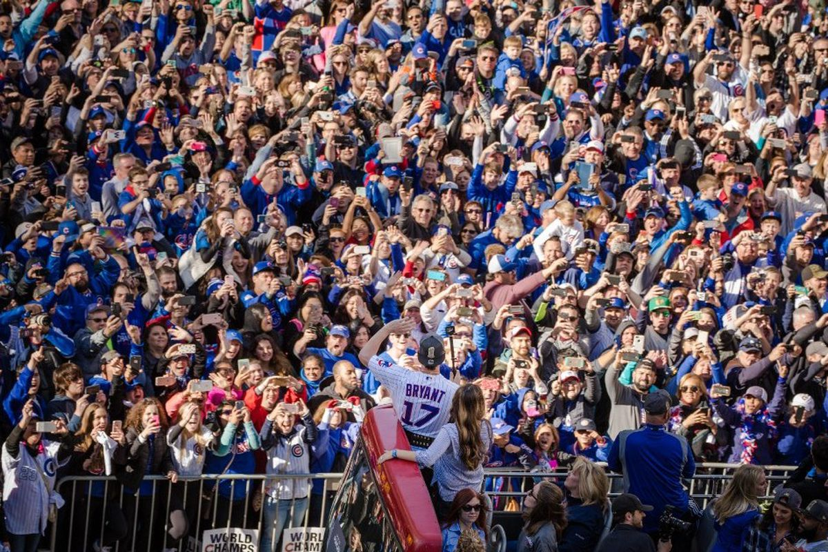 aa330bb76 Kris Bryant pumps up the crowd during the Cubs parade.