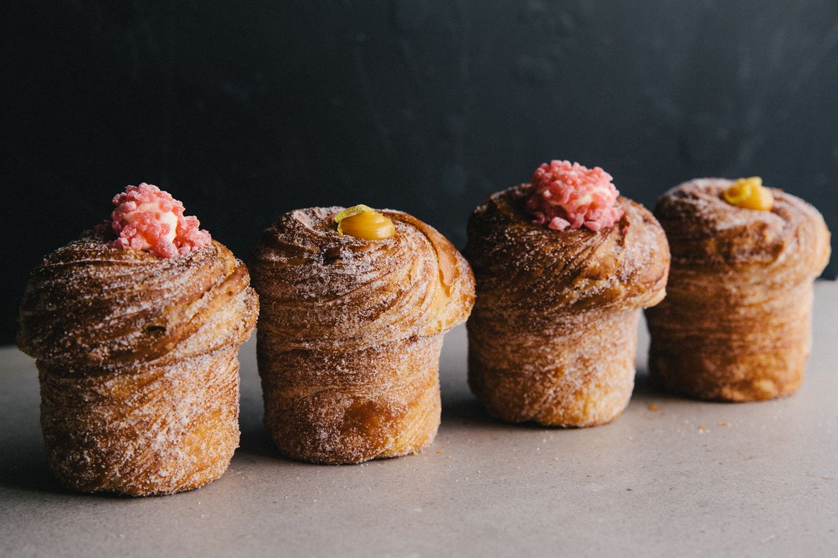 A lineup of sugar-dusted Cruffins