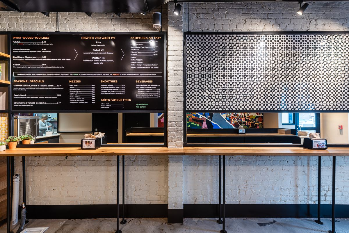 A large menu on the wall