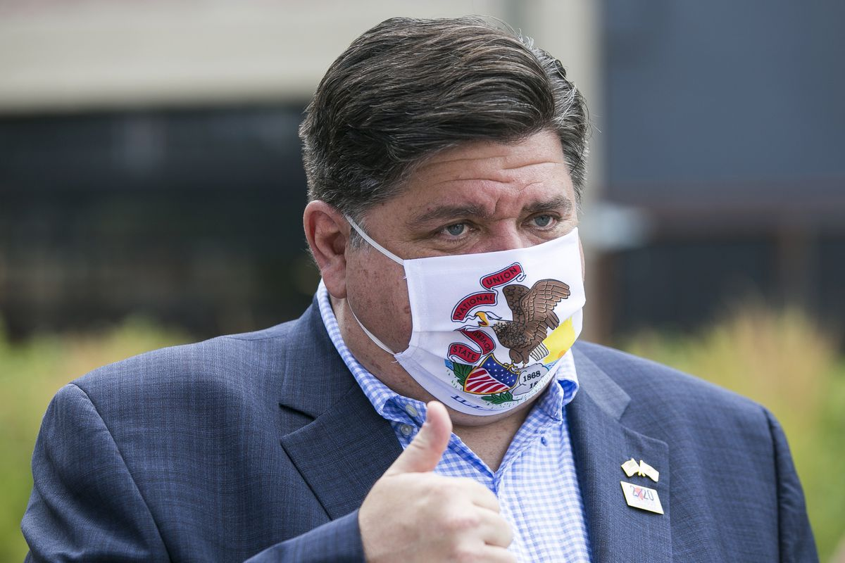 Gov. J.B. Pritzker during a meeting with residents at City Market in Rockford last year.
