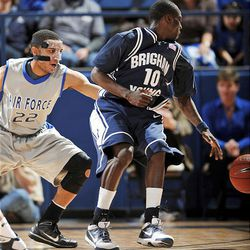 BYU guard Michael Loyd Jr., right, spins away from Air Force guard Avery Merriex in the first half of the Cougars' victory over the Falcons.