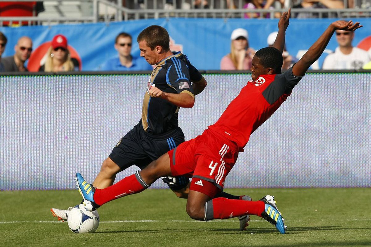 How did I not notice this picture back in May?  That's some awesomely stylish defending form Doneil.