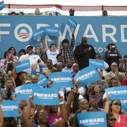 People cheer as President Barack Obama speaks at a campaign event at  G. Richard Pfitzner Stadium, Friday, Sept. 21, 2012, in Woodbridge, Va.