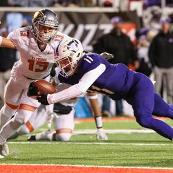 Lehi's Kade Moore dives into the end zone to score on Skyridge, putting Lehi up 7-0 after the PAT, in the 5A football state championship game at Rice-Eccles Stadium in Salt Lake City on Friday, Nov. 17, 2017.