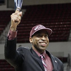 Rick Ray waves a cowbell after being introduced as Mississippi State's head basketball coach on Monday, April 2, 2012 at the school's Humphrey Coliseum in Starkville, Miss. The 40-year-old Ray comes to Mississippi State after spending two years as the top assistant at Clemson. The cowbell is a time honored noise maker at Mississippi State.