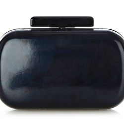 """Sleek, shiny and perfect for cocktail attire. Warehouse <a href=""""http://warehouse.andotherbrands.com/lucite-clutch-en-US?ctry=US"""">lucite clutch</a>, $50."""