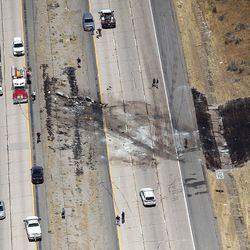 Scene of a fatal plane crash on I-15 in Riverdale on Wednesday, July 26, 2017. All four people on board died.