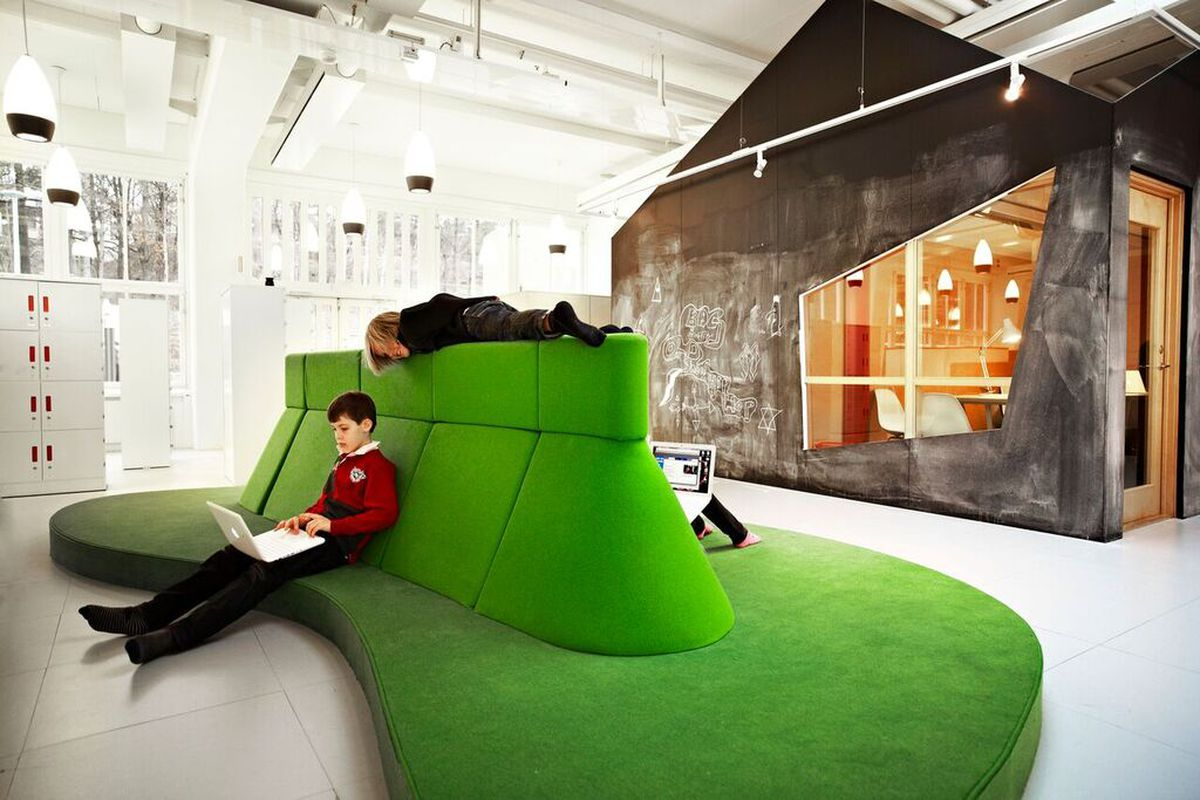 child sitting on green sofa