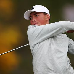 Lone Peak's Kihei Akina tees off on the 18th hole as he competes in the 6A boys state tournament at Davis Park Golf Course in Kaysville on Tuesday, Oct. 5, 2021.