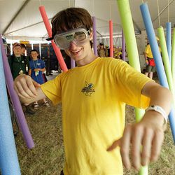 Boy Scout Matt Smith of Middletown, N.J., makes his way through a simulated drug-impaired obstacle course at the National Scout Jamboree at Fort AP Hill in Virginia Tuesday. Scouts from Utah are attending the event.