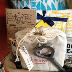 """From Fairmount boutique Ali's Wagon, this <a href=""""http://store.aliswagon.com/belogiba.html"""">Beer Lover's Gift Basket</a> ($70) will blow their socks off with four USA-crafted glasses made from old Corona bottles, an engraved bottle opener, and an illustr"""