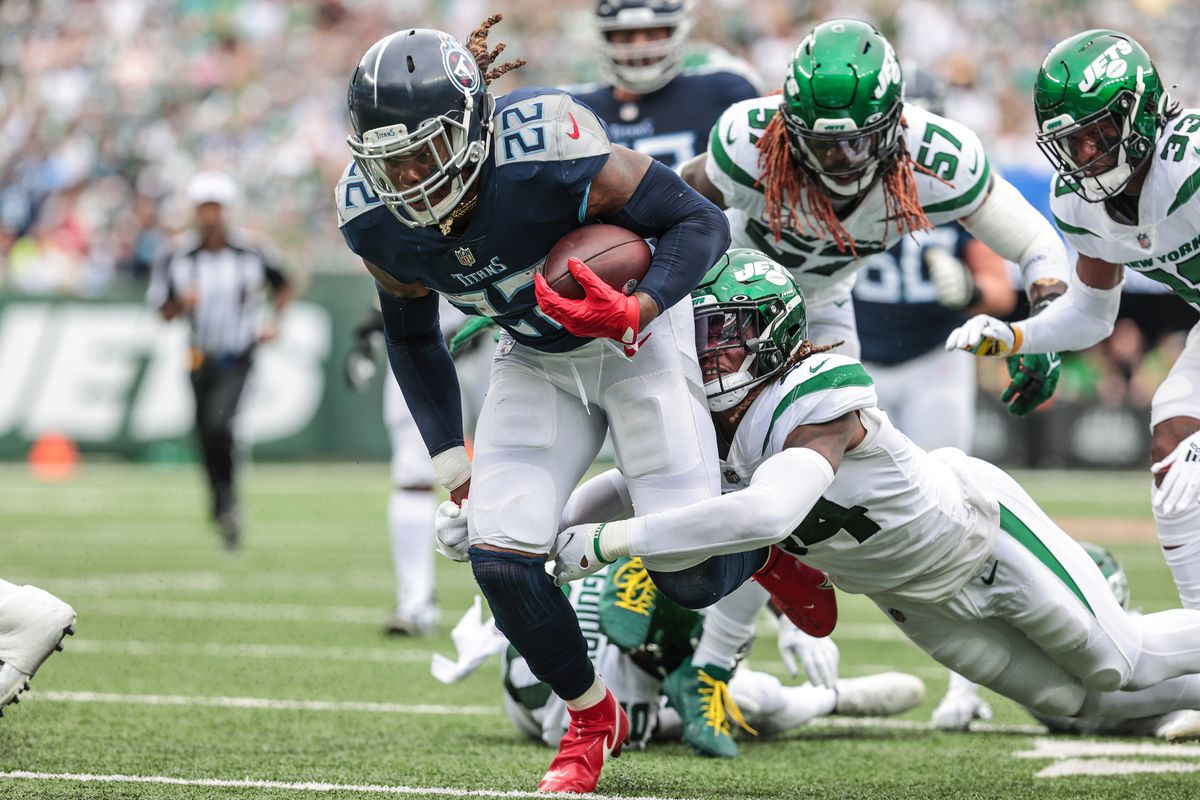 Tennessee Titans running back Derrick Henry (22) runs for yards as New York Jets defensive tackle Foley Fatukasi (94) tackles during the second half at MetLife Stadium.