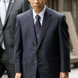 Olympus Corp.'s former President Tsuyoshi Kikukawa arrives at Tokyo District Court in Tokyo Tuesday, Sept. 25, 2012.  Kikukawa admitted guilt Tuesday in a cover-up scandal of massive investment losses at the major Japanese camera and medical equipment company.