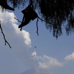 A plume of ash and steam rises from Popocatepetl volcano as seen from San Nicolas, Mexico, Friday, April 20, 2012. Mexico's Popocatepetl volcano is continuing to spout gases and hot rock fragments and it is dusting towns on its flanks with volcanic ash. (AP Photo/Dieu Nalio Chery)