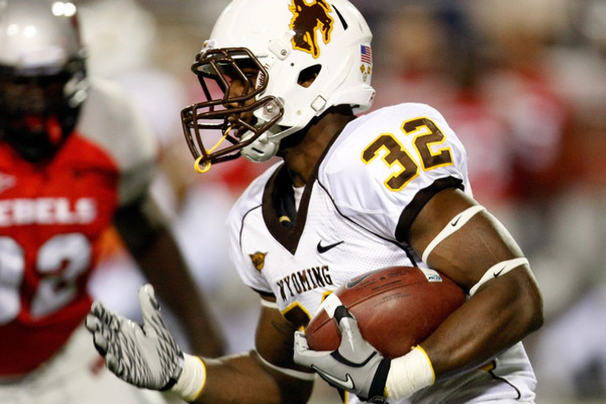 LAS VEGAS - NOVEMBER 13:  Alvester Alexander #32 of the Wyoming Cowboys runs for a 72-yard touchdown against the UNLV Rebels during their game at Sam Boyd Stadium November 13 2010 in Las Vegas Nevada.  (Photo by Ethan Miller/Getty Images)