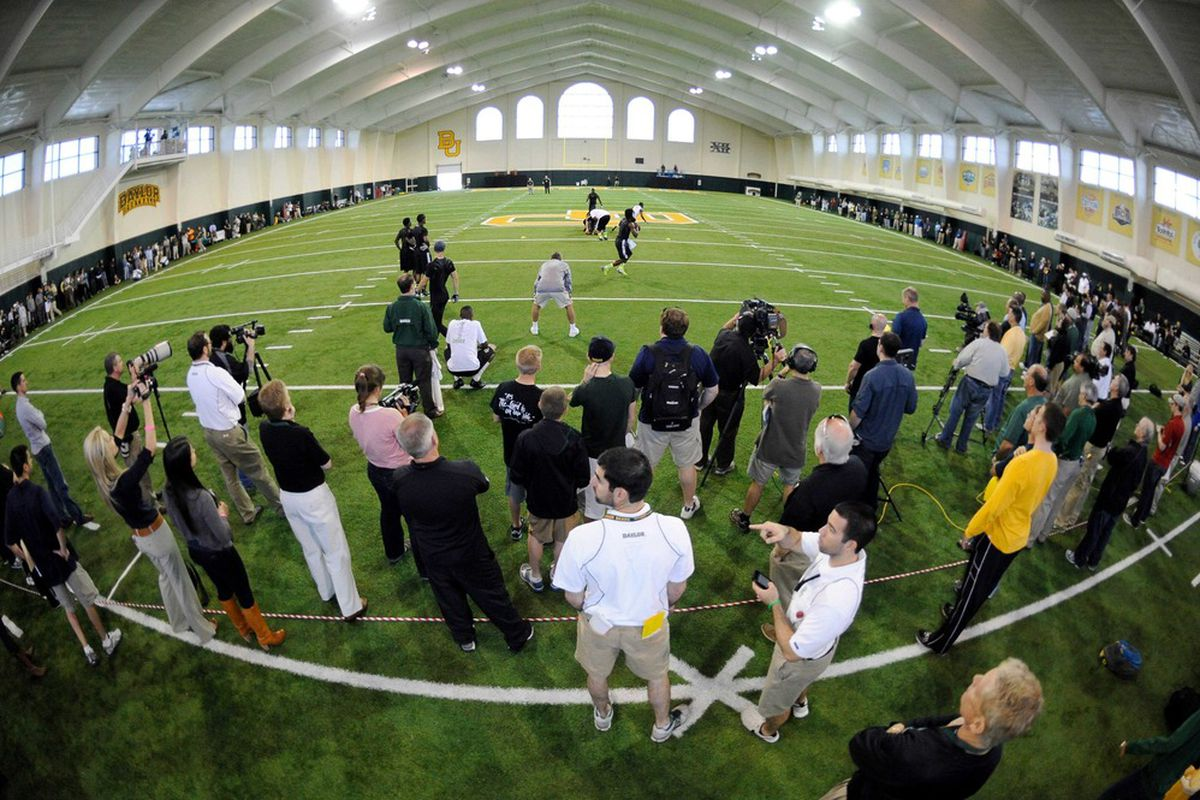 Mar 21, 2011; Waco, TX, USA; A general view as NFL scouts watch Baylor Bears quarterback Robert Griffin III (10) throw during the Baylor pro day at the Allison Indoor Facility. Mandatory Credit: Jerome Miron-US PRESSWIRE