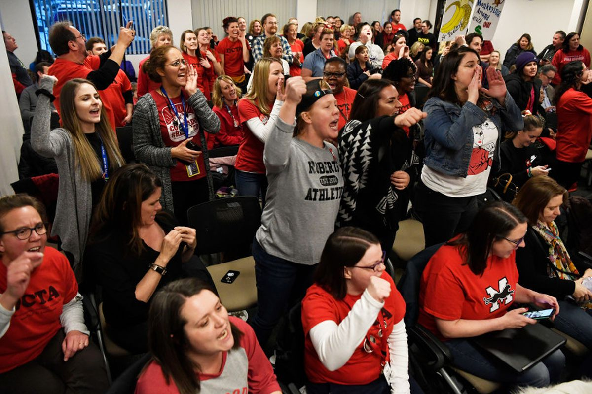 Denver teachers and their supporters get fired up before the Denver Classroom Teachers Association negotiations with Denver Public Schools district officials on Friday evening.