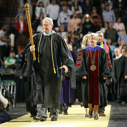 Salt Lake Community College President Deneece Huftalin, right, faculty members and dignitaries enter the Maverik Center for the school's commencement ceremony in West Valley City on Friday, May 6, 2016.