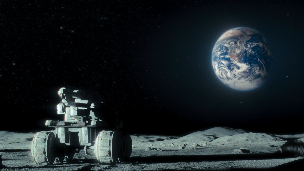 Moon - lunar rover on the moon's surface with Earth rising in the background