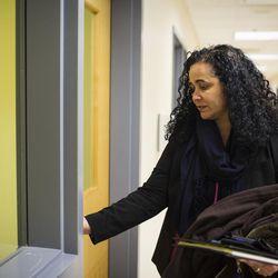 Raisa Carrasco-Velez, director of Multicultural Affairs & Community Development at St. John's Preparatory School, opens the door to her office in Danvers, Massachusetts on March 13, 2017.