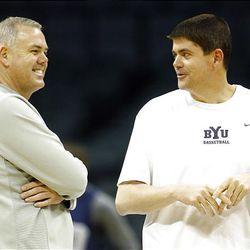 BYU coach Dave Rose, left, shares a laugh with assistant Dave Rice during Wednesday's practice in Oklahoma City.