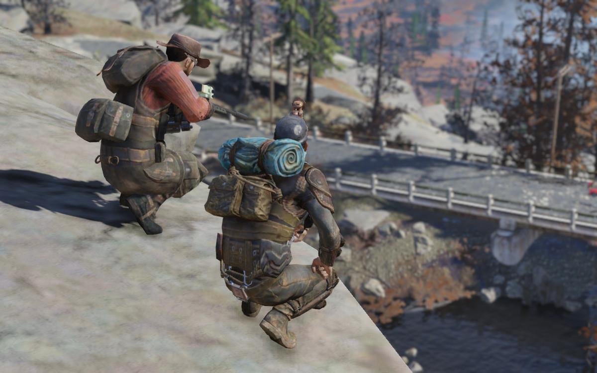 Fallout 76 - two players on a ridge above a bridge