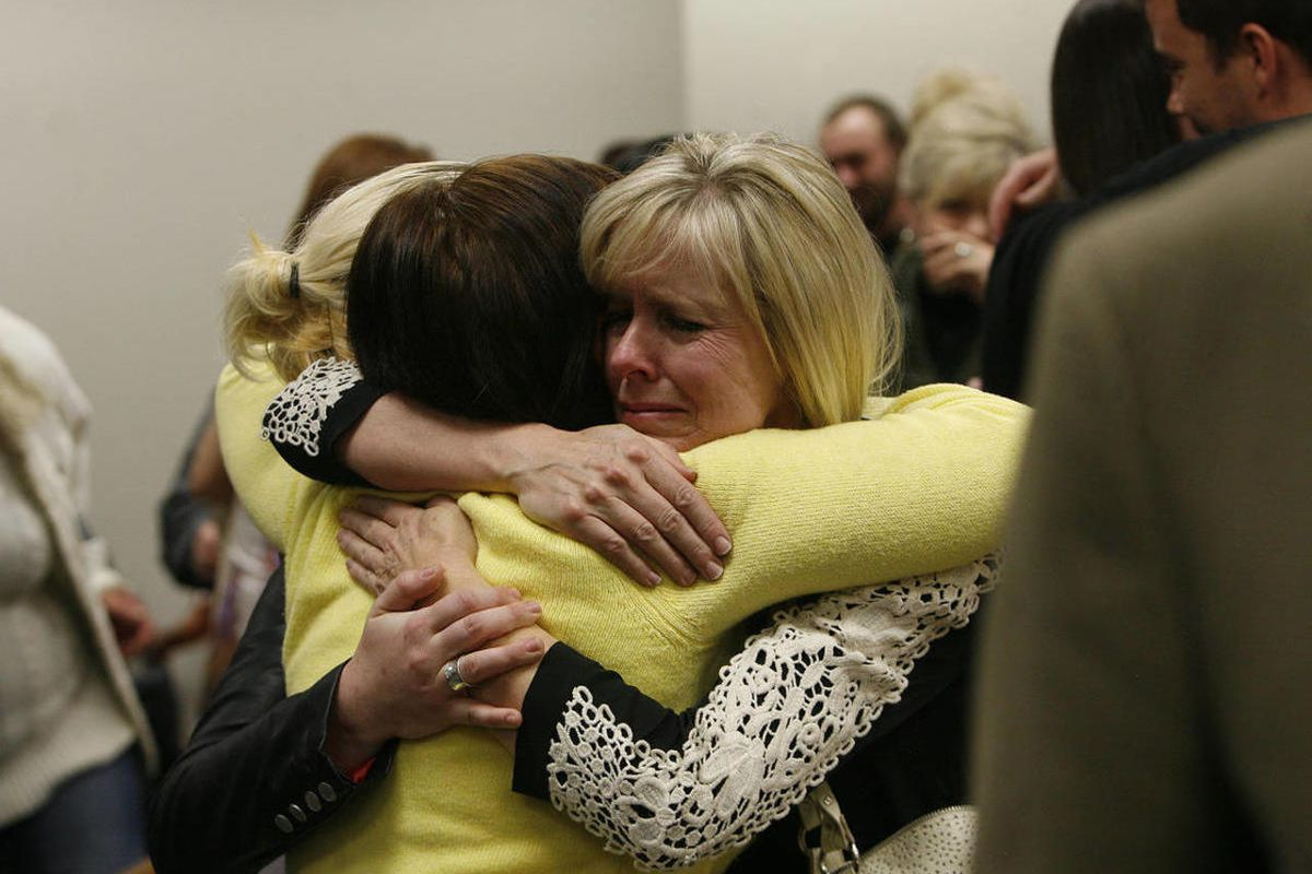 """FILE""""""""Linda Cluff, sister of Michele MacNeill, hugs friends after court was adjourned following the guilty verdicts against Martin MacNeill. MacNeill was found guilty of murder and obstruction of justice early Saturday, Nov. 9, 2013."""