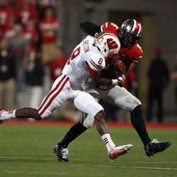 Braxton Miller pushes off a defender.