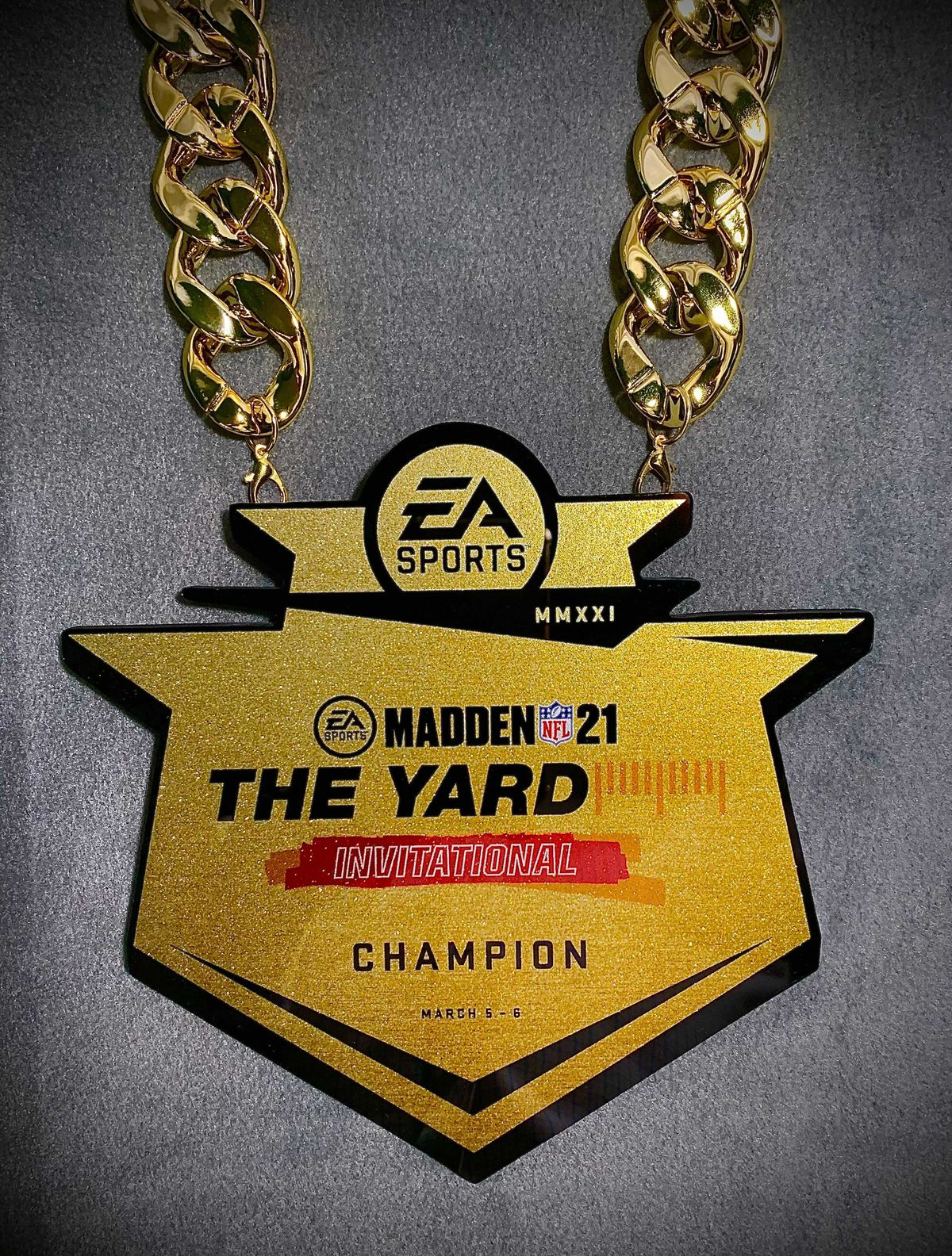 Image of a garish, electroplated gold chain and medallion for the winner of the Madden NFL 21 The Yard Invitational