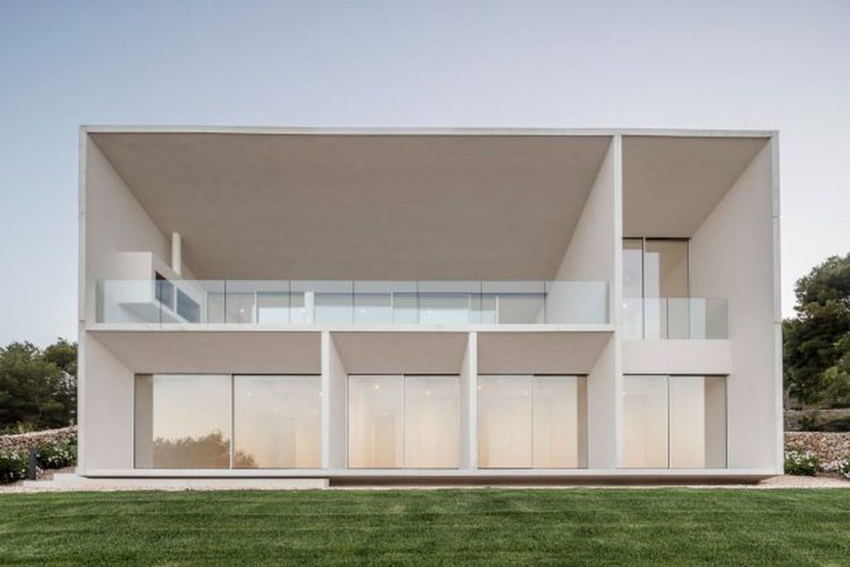 White concrete house with terrace
