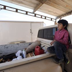 Jarett Hunt sits on the back of a truck outside of his home in Halchitain Halchitain Halchita, San Juan County, which is part of the Navajo Nation, on Friday, April 17, 2020.The Navajo Nation has one of the highest per capita COVID-19 infection rates in the country. Jarett is asymptomatic but got tested earlier in the day to be safe.