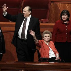 President Thomas S. Monson and his wife Frances wave as they exit the conference center following the morning session of General conference Sunday, Oct. 7, 2012.